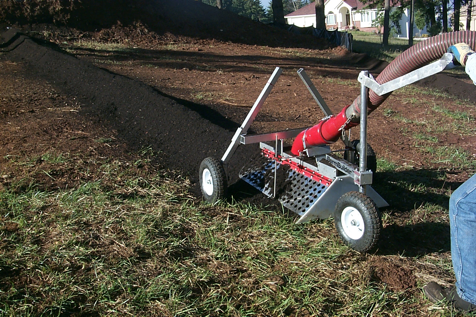 Ecoberm installed with an Express Blower truck and a bermbuilder