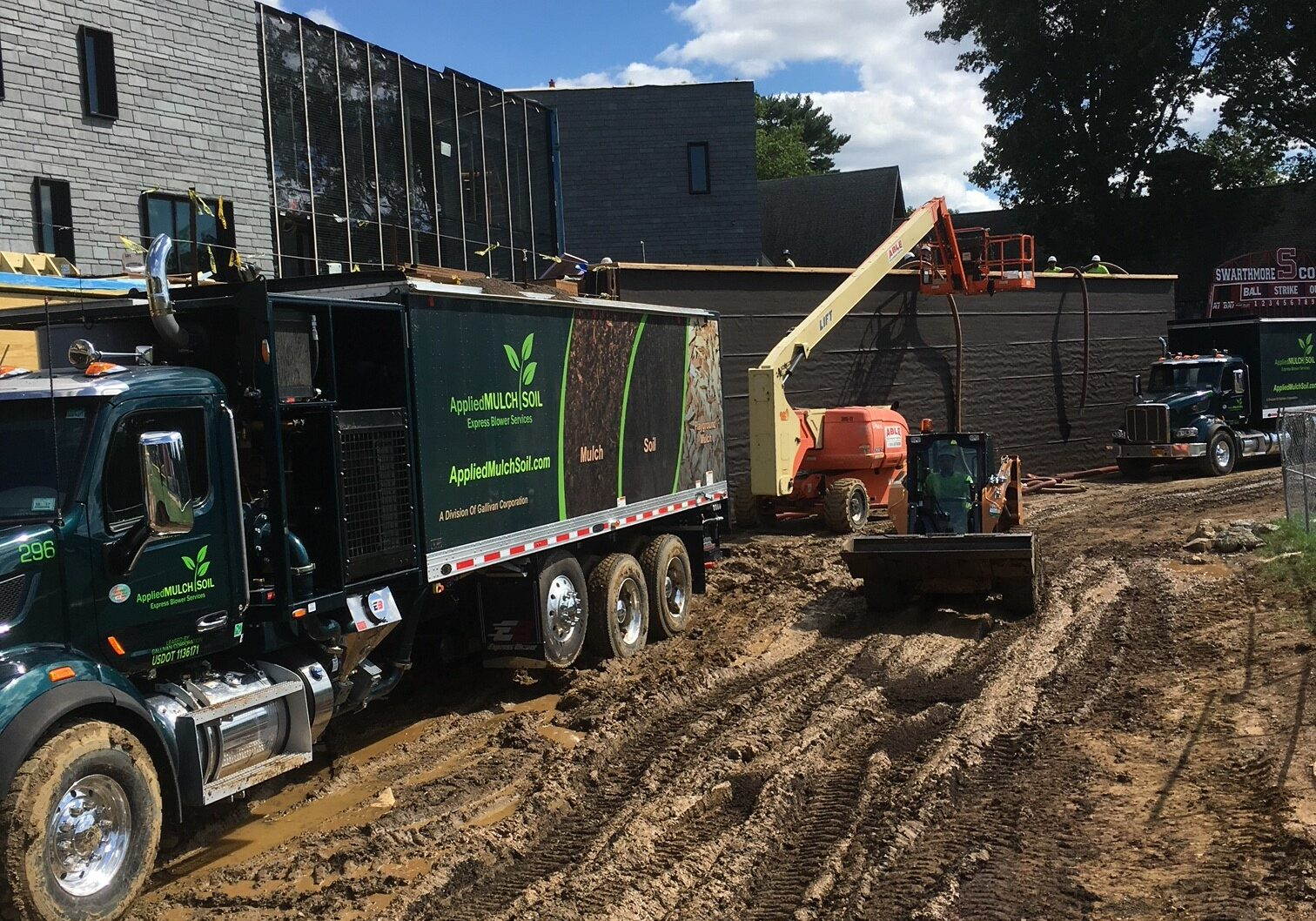 Blowing in Material Over a Retaining Wall at a Construction Site